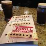 A couple pints of Guinness settle in for a good read